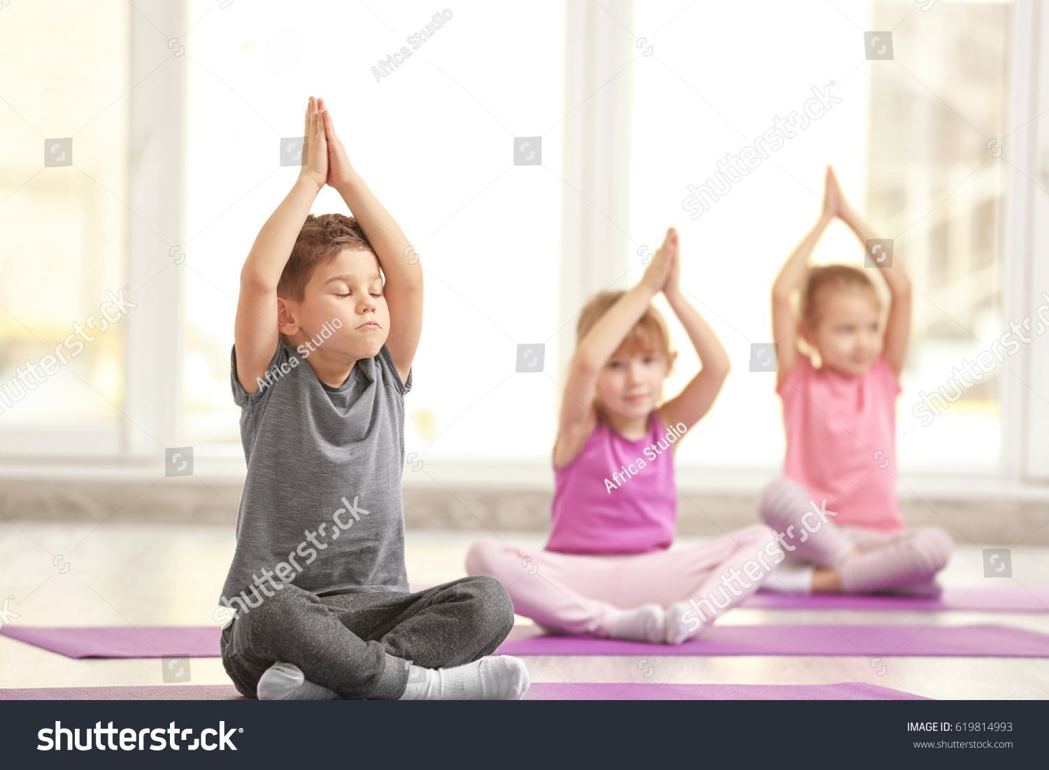 stock-photo-group-of-children-doing-gymnastic-exercises-619814993
