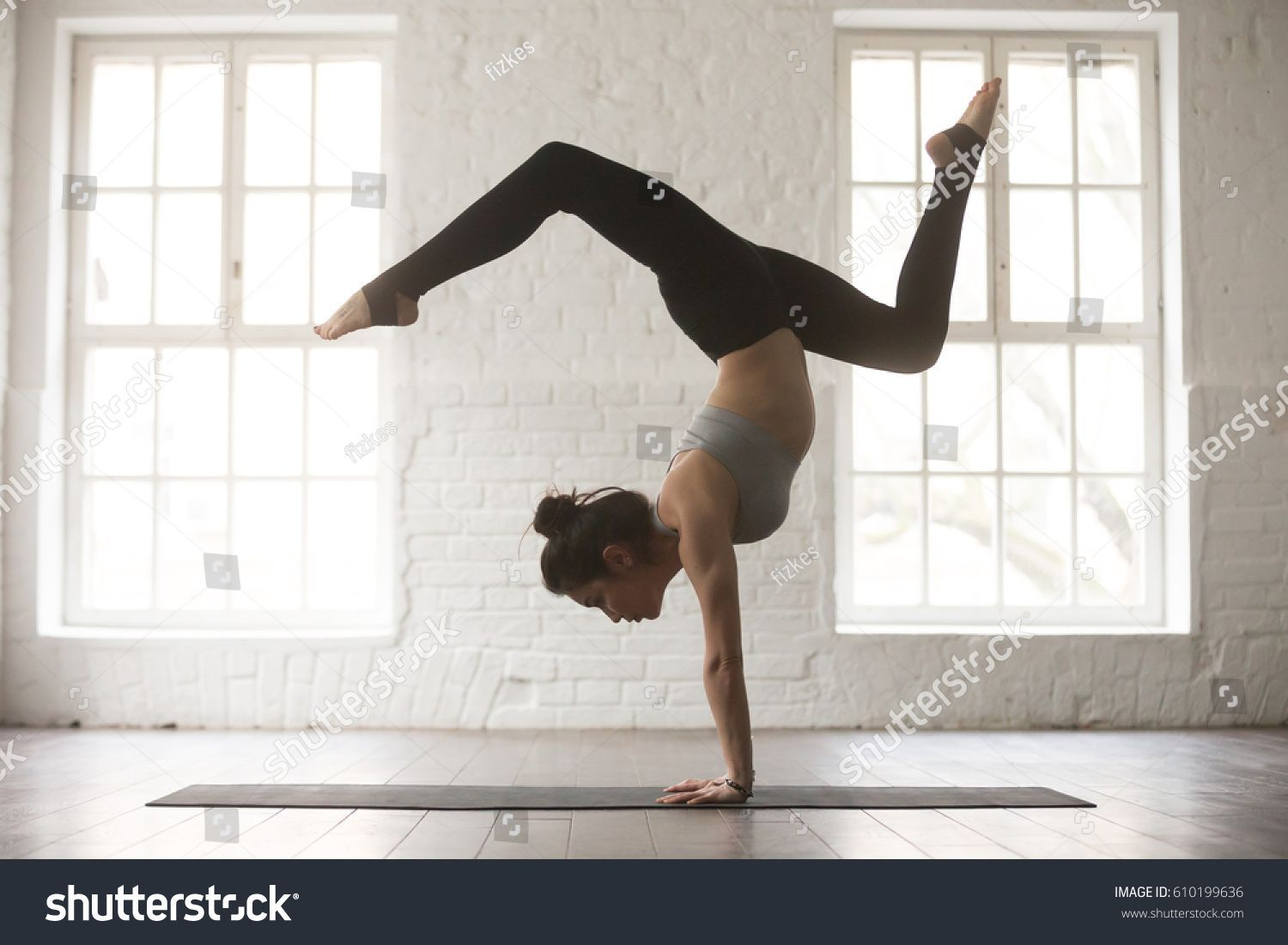 stock-photo-silhouette-of-young-cool-attractive-yogi-woman-practicing-yoga-concept-standing-in-adho-mukha-610199636